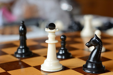 The white queen on the old chess board