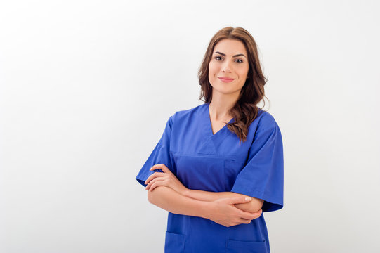 Smiling medical nurse in medical doctor uniform  isolated over white background.