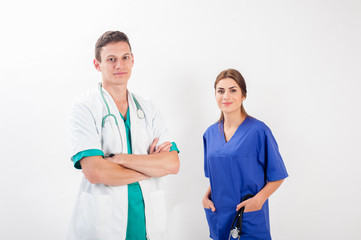Medical professionals standing isolated. Young caucasian man and young woman nurse in medical scrubs