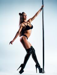 Woman poledancing