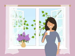 A young woman is drinking coffee by the open window. Outside the window there are tree branches with green leaves. There is a bouquet of lilacs on the windowsill. Vector illustration