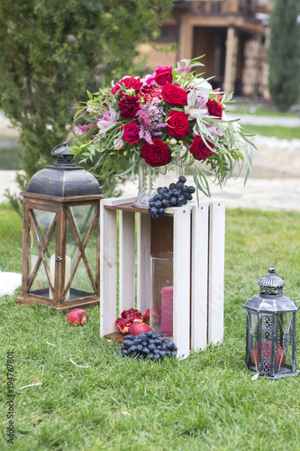 Wine color flowers on a wedding arch with tulle fabric and wooden wine color flowers on a wedding arch with tulle fabric and wooden decorations copy space junglespirit Choice Image