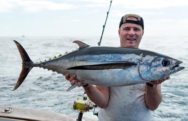 Angler with white tuna fish