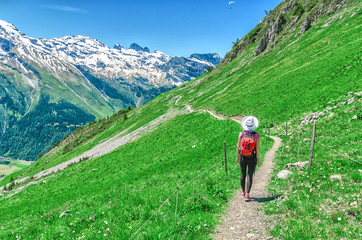 Swiss Alps. A man in a white hat, a traveler in a mountain alpine country. Landscape of the Swiss Alps, Engelberg Resort