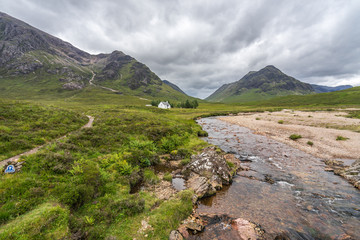 Stunning Higlands landscape with River Coupal and Lagangarbh cottage in Glencoe valley, Scotland, Britain