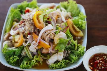 Close up of mix spicy sea food salad