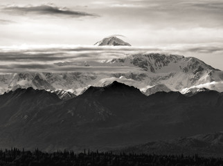The tallest mountain in North America, Denali, in a rare view between the clouds
