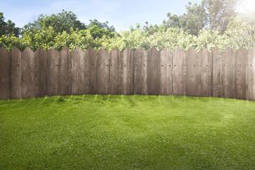 Wooden fence on green garden