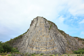 Buddha image on cliff of the mountain.