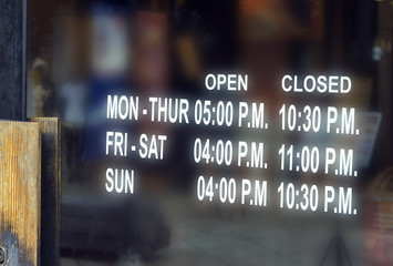 Open and closed sign outside a restaurant, store, office or other
