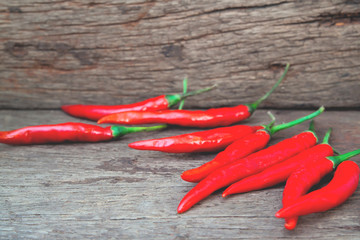 Hot red peppers on wooden table, Food ingredient