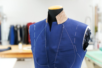 Partially completed new blue jacket on a mannequin