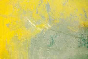 abstract hand painted grey canvas texture with yellow strokes