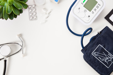 Doctors Office Desk with Blood Pressure Instrument and Stethoscope