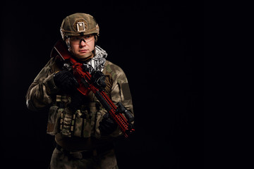 Picture of soldier in helmet with gun on empty black background