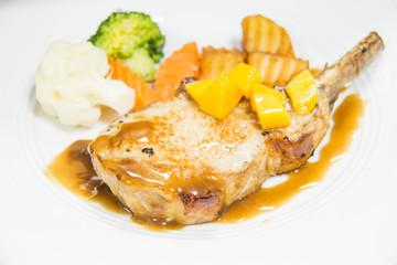 Lamb steak with sauce and potato