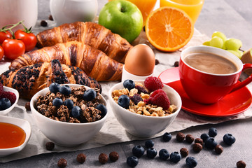 Breakfast served with coffee, juice, croissants and fruits