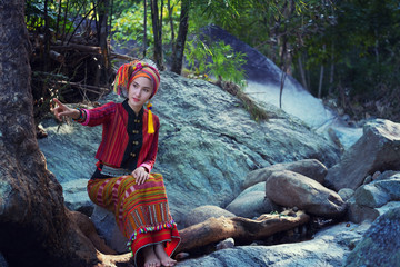 Beautiful Asian woman with karen traditional dress explore in forest in local country Thailand, Asia