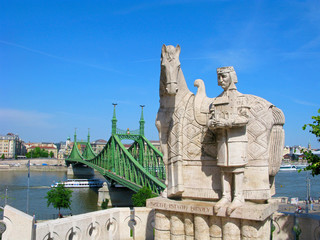 Hungary, Budapest. Statue of St. Stephen on Gellert Hill in Budapest and the Liberty bridge over Danube river.