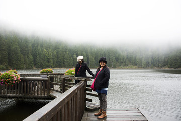 Asain thai women mother and daughter travel and posing at Mummelsee lake while raining in Black Forest or Schwarzwald at Baden-wurttemberg of Stuttgart, Germany