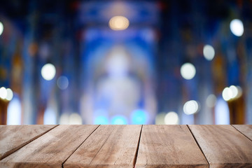 Empty wood table desk with bokeh.