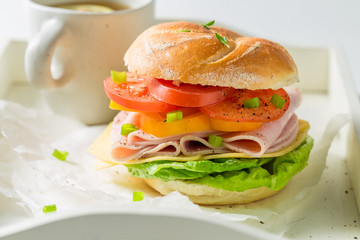 Crisp sandwich with fresh ingredients and tea