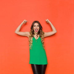 Young Woman Is Shouting With Arms Outstretched