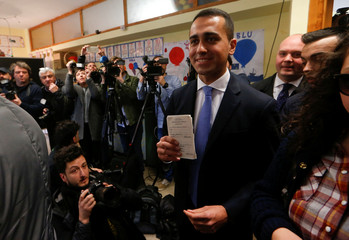 5-Star Movement leader Luigi Di Maio arrives to cast his vote at a polling station in Pomigliano d'Arco