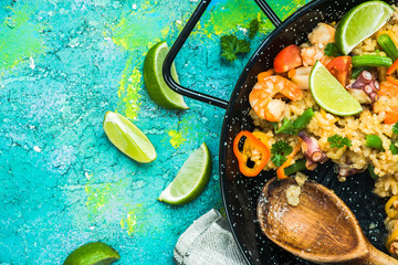 Spanish seafood paella made for sharing with friends