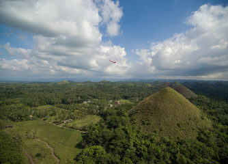 Chicolate Hills in Bohol, Philippines. Landscape. Helicopter in Background