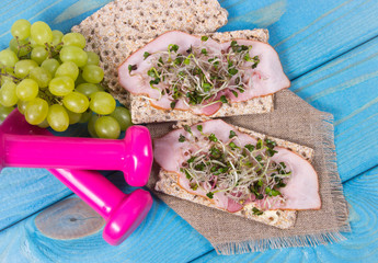 Healthy diet. Sandwiches with ham and broccoli sprouts on crisp bread.