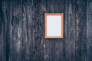wooden picture frame on old wooden surface background