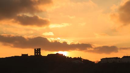 Silhouette of Scarborough Castle at sunrise in Winter.