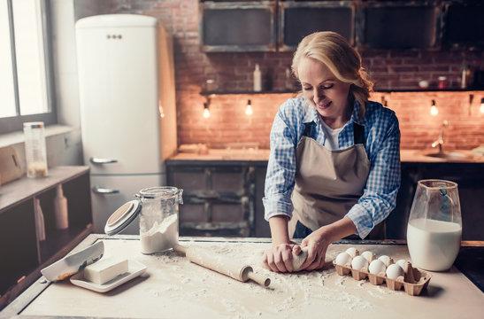 Senior woman cooking on kitchen