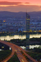 sunset scene with Vienna city skyline and Danube river. Austria