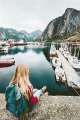Tourist woman enjoying fjord view of Lofoten islands in Norway Travel lifestyle concept adventure outdoor summer vacations
