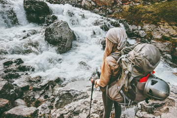 Adventurer travel woman hiking with backpack at river in mountains healthy lifestyle concept active summer vacations sport outdoor