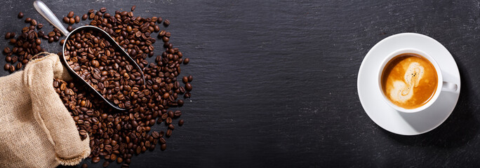 cup of coffee and coffee beans in a sack, top view Wall mural