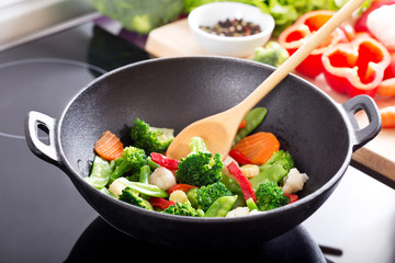 cooking stir fried vegetables in a wok