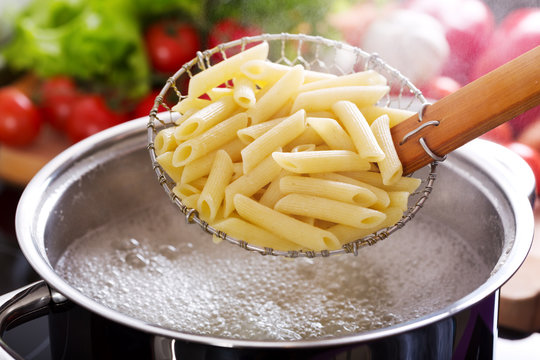 Cooking pasta in a pot with boiling water