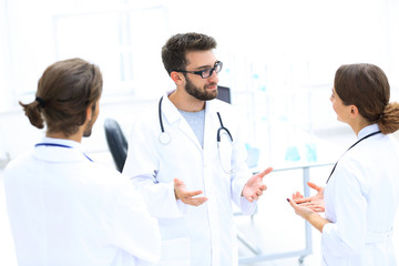 Medical staff discuss in a modern hospital room