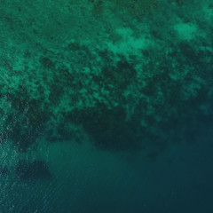 Aerial top drone view of transparent sea water surface