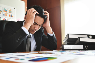 Businessman having headache.