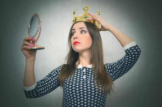 Selfish woman. Arrogant disgruntled girl with high self esteem. Egoist person woman with golden crown on her head. Dissatisfied winner.