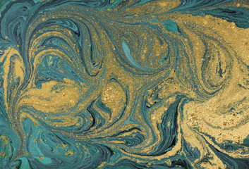 Marble abstract acrylic background. Nature green marbling artwork texture. Golden glitter.