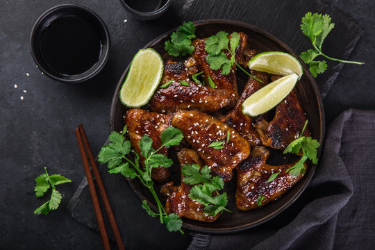 roasted teriyaki chicken wings, served with lime, cilantro and sesame seeds