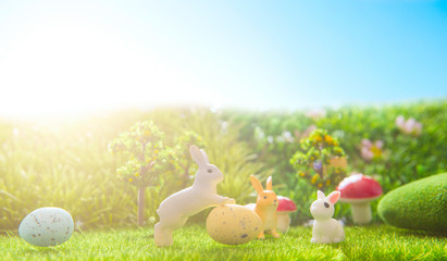 Easter rabbits toy on spring green grass. Fairy tale