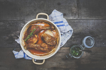 roast chicken with pesto on wooden background