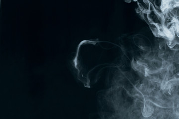 Texture of white smoke on a black background