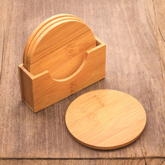 Beverage coaster mug made from wooden material on retro background.